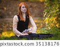 Red-haired woman in Victorian outfit  35138176