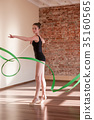 Young ballerina repetition. Rhythmic gymnastics 35160565
