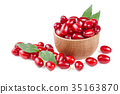 dogwood berry with leaf in a wooden bowl isolated 35163870