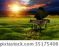 Piano on the meadow under the dramatic sky 35175406