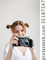 portrait smiling girl taking photo retro camera 35187347