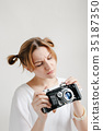 portrait smiling girl taking photo retro camera 35187350