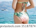 Sexy back of  woman in  bikini  35187874