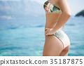 Sexy back of  woman in  bikini  35187875