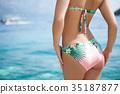 Sexy back of  woman in  bikini  35187877
