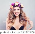 Cute Model Woman wearing Flowers Wreath. 35190924