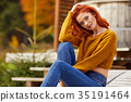 Outdoor atmospheric lifestyle photo of young beautiful lady. War 35191464