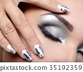 Beautiful girl with the silver makeup and nails. 35192359