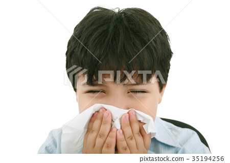 sick boy blowing his nose, white background 35194256