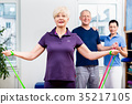 Older patients in physiotherapy using power band 35217105