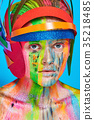 Model with colorful makeup in multicolored helmet 35218485