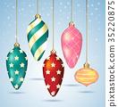 Christmas balls ornaments hanging on gold thread. 35220875