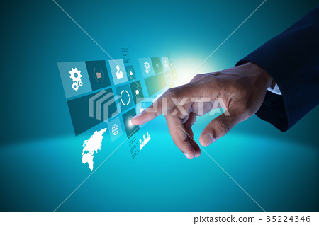 Businessman pressing virtual buttons 35224346