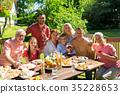 happy family having dinner or summer garden party 35228653