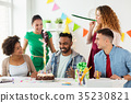 team greeting colleague at office birthday party 35230821