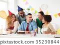 corporate team celebrating one year anniversary 35230844