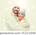 smiling couple in winter clothes hugging 35231606