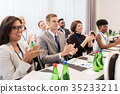 people applauding at business conference 35233211