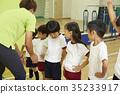 Gymnastics class instruction 35233917