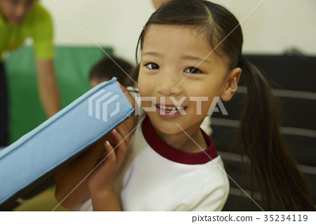 Girl preparing to exercise room mat exercise 35234119