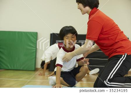 Kids doing exercise on mats 35234195