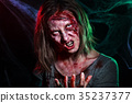 Close-up portrait of horrible zombie woman with 35237377