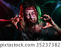 Close-up portrait of horrible zombie woman with 35237382