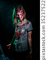 portrait of horrible zombie woman with wounds 35237522