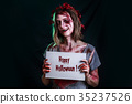 Close-up portrait of horrible zombie woman with 35237526