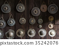 Thai small Gongs and cymbals on a wooden wall 35242076