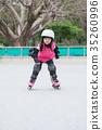 girl play roller skating 35260996