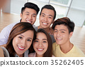 Taking selfie together 35262405