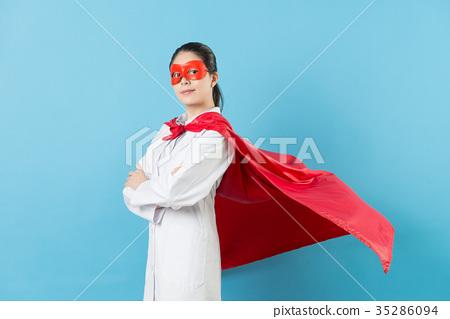 confident female doctor wearing superhero costume 35286094