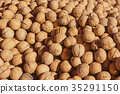 Nuts in autumn. Fresh walnuts on the market. 35291150