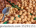 Nuts in autumn. Fresh walnuts on the market. 35291151