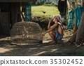 Rural farmer with chicken at countryside,Thailand.The lifestyle 35302452