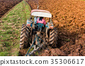 Asia farmer using tiller machine in rice field. 35306617