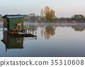 A small lake with fisherman's hut at sunrise 35310608