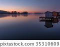 A small lake with fisherman's hut at sunrise 35310609
