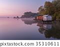 A small lake with fisherman's hut at sunrise 35310611