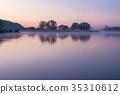 A small lake with fisherman's hut at sunrise 35310612