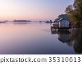 A small lake with fisherman's hut at sunrise 35310613