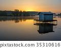 A small lake with fisherman's hut at sunrise 35310616