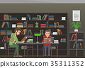 Two Boys Sit at Table and Read Books in Library 35311352