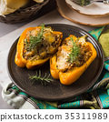 Bell peppers stuffed with barley and meat 35311989