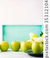 White green pastel background with apples 35312104