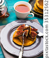 Eating pumpkin pancakes with figs and honey 35312562