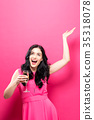 Young woman holding a champagne flute  35318078