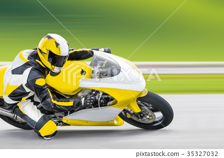 Motorcycle practice leaning into a fast corner on track 35327032