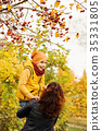 Happy Autumn Family in Fall Park Outdoors 35331805